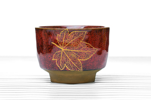Deep Footed Tea Bowl With Speckled Crimson Glaze And Golden Leaf Pattern